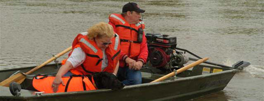 Dog and handler in search boat